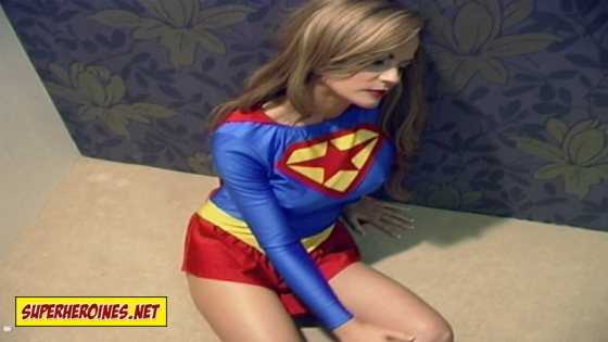 Supergirl lying on floor unconcious