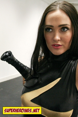 Superheroine about to punch a man