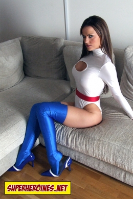 Jasmine Sinclair sitting on sofa in Power Girl costume