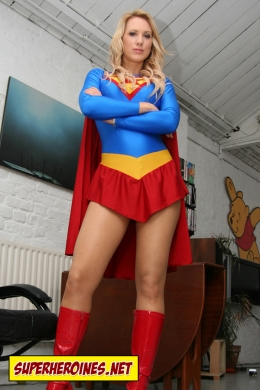 Rebecca posing in her Supergirl costume