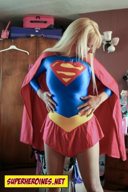 Supergirl transforms into her costume