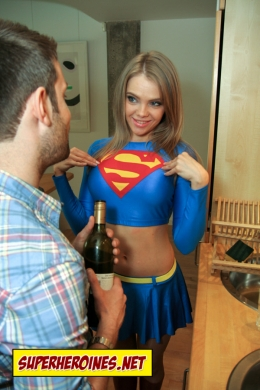 Supergirl pointing at her chest